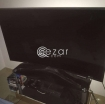 curved 55 inch UHD TV with quality glass cabinet photo 2