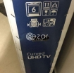 curved 55 inch UHD TV with quality glass cabinet photo 1