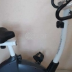 Stationary bike, just 4 month olds - Moving sale photo 1