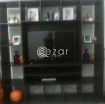 Elegant tv stand with curious photo 1