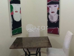 Dining table with 2 chairs for sale in Qatar