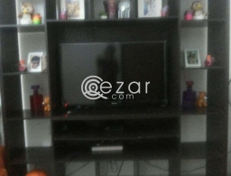 Elegant tv stand with curious for sale in Qatar
