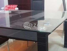 Dining table with eight leather chairs for sale in Qatar