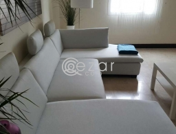 Double L sofa like new for sale in Qatar