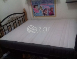 Ikea King size Mattress with bed frame for sale in Qatar