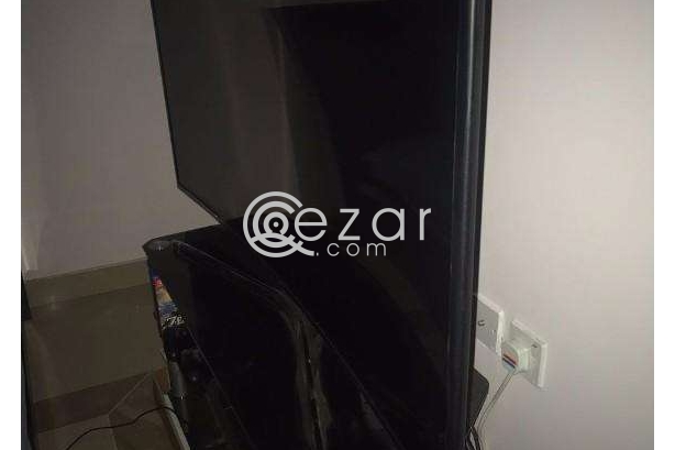 curved 55 inch UHD TV with quality glass cabinet photo 3